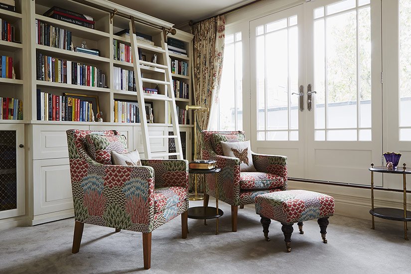 Reupholstered armchairs and bespoke footstool
