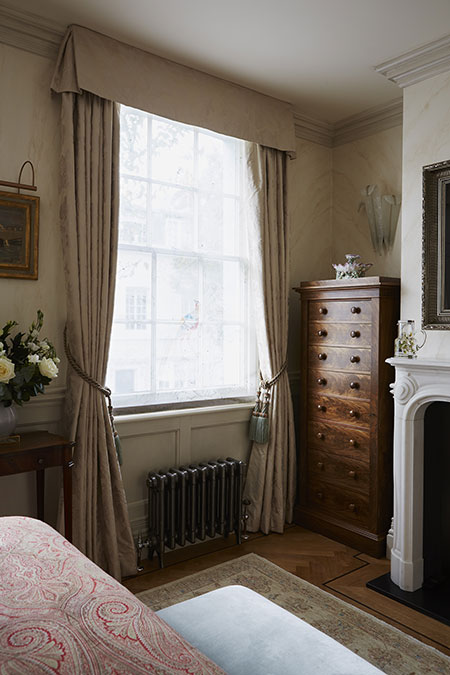 Triple pleat headed curtains with soft valance pelmet with box pleat on the corners